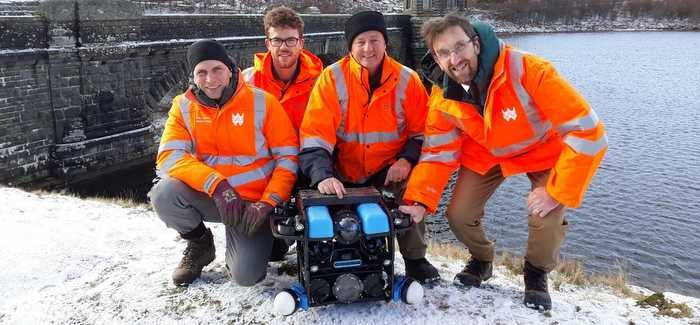 L-R: Richard Williams (Dwr Cymru), Jordan Jolly, Sean Killgallon (Abyss Solutions) and Paul Gaskin (Dwr Cymru) with the ROV at Craig Goch Reservoir.