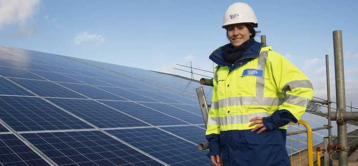 Julia Clarke surveys the solar panels at Sutton Bingham WTW, which is near Yeovil
