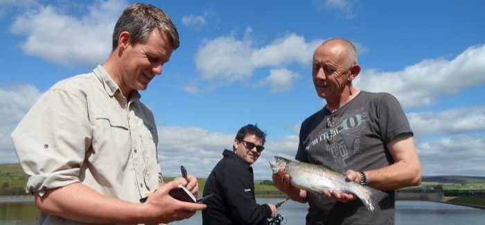 Simon Lee (left) on duty at one of Northumbrian Water's fishing spots