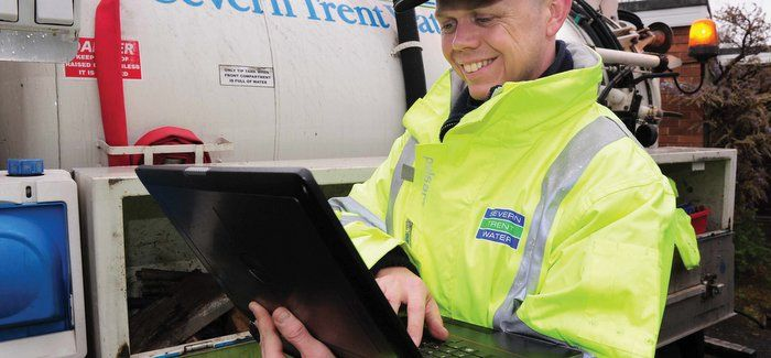 Field workers are using a mobile GIS application running on laptops