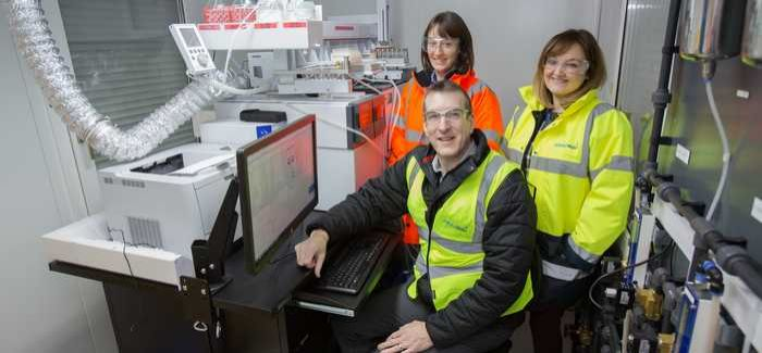 Affinity Water's Alice Elder, Debbie Loftus-Holden and Matthew Rawlinson with the GCMS instrument