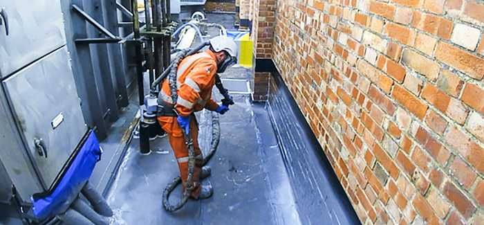 Spray lining an asset with a waterproof polyurea coating