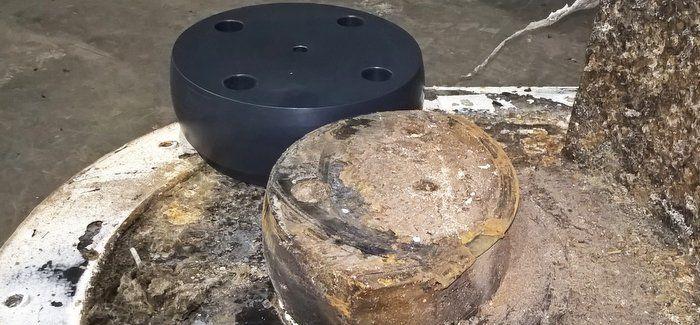 A worn bearing next to a new bearing