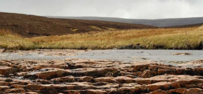 A dry river bed in a peat upland in Northern England: intensive water use will further aggravate drought conditions in some parts of the UK. Image: Catherine Moody