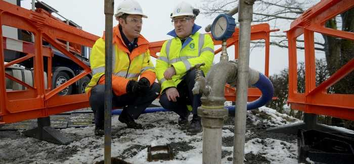 Graham Neave, operations director, Northumbrian Water, and Matthew Stephenson, operations director, Aquaology, monitor ice entering a main during Northumbrian Water ice-pigging trials