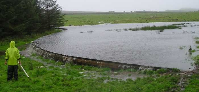 A pilot pond in the Belford Burn catchment shows its function as a 'leaky dam', slowing runoff during a storm