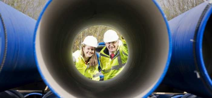 Sara Venning and Danny Kennedy at the delivery of the pipes
