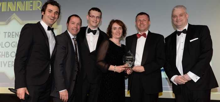 The Outstanding Innovation 2014 winners (Severn Trent Water's Julie Hart; Marc Bracken, of Echologics; Neil Dixon and James Flint, from Loughborough University) with Ofwat's Mark Worsfold (right) and awards host Patrick Monahan (left)