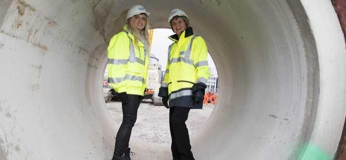 Scotland's deputy first minister Nicola Sturgeon (rt) with Scottish Water apprentice Courtney Mitchell