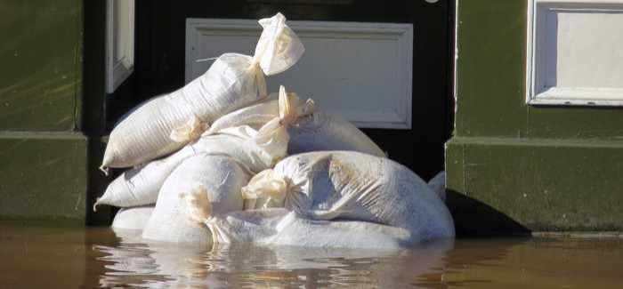 Natural resources minister Carl Sargeant is concerned that thousands of homes at high flood risk in Wales will pay more for their flood insurance