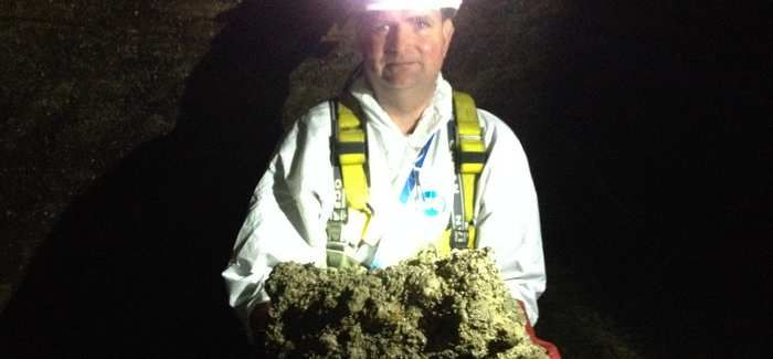 Sewer worker Tim Henderson holding a piece of fatberg he grabbed out of the 'river of fat'