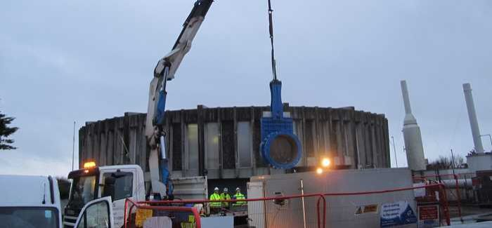 One of the new valves is lifted into place on site in Littlehampton