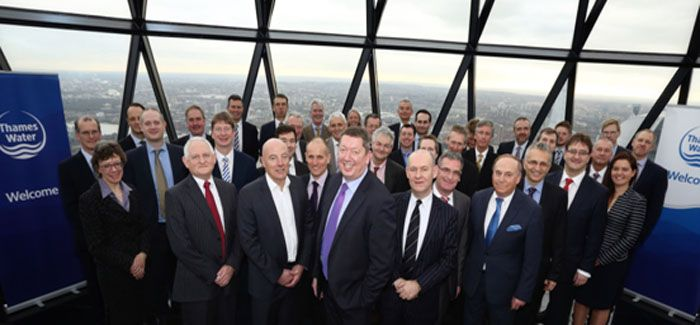 Thames Water's Martin Baggs and members of his senior team join leaders of companies in the eight2O and infrastructure alliances at the Gherkin for the signing ceremony