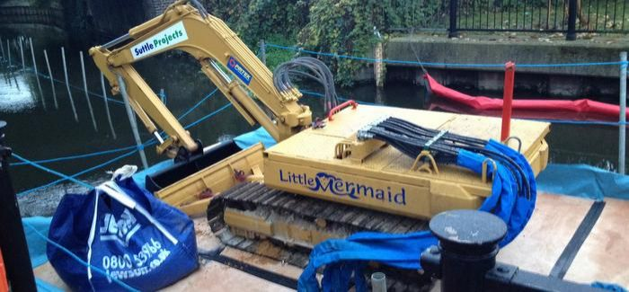 A conventional mini excavator was converted to create the submersible digger