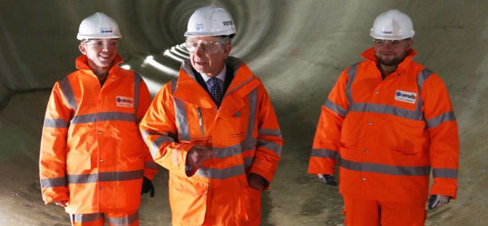 Prince Charles with Thames Water apprentices Liam Kelleher and Tony Brown inside the Lee Tunnel