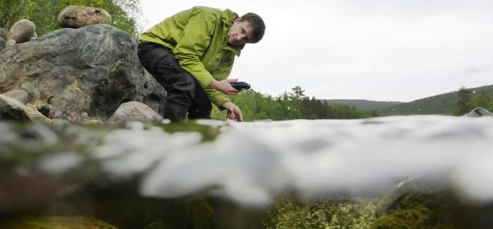 Matt Turley monitors water quality in Finland's Teno River