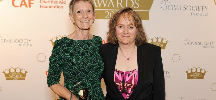 WaterAid's Barbara Frost (left) receiving the award from Baroness Jill Pitkeathley