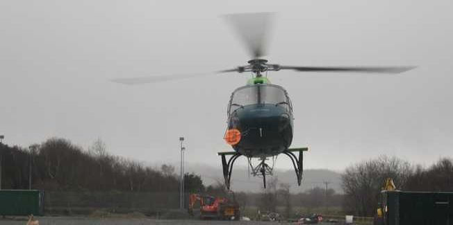 The helicopter landing at Dolgarrog