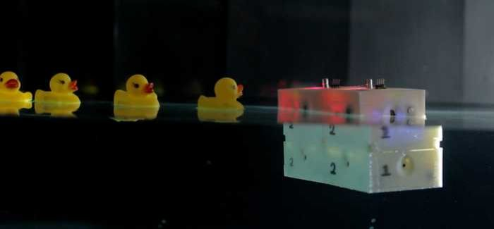 The robot floats on the surface of the water and is made of configurable modules
