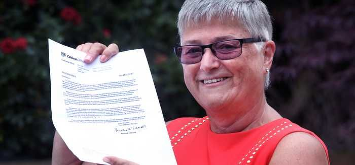 Lynda Chamberlain with her letter from the Queen