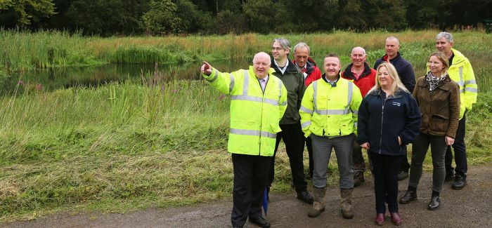 Dermott McCurdy, project sponsor at NI Water, leads a tour of the new wetland