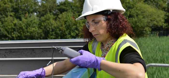 Dr Joana Dias testing at a wastewater treatment plant