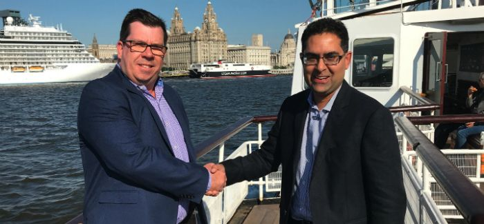 Aqualogic MD Ben Rice and Trimble sales director Saad Latif shake hands on the mutual company agreement