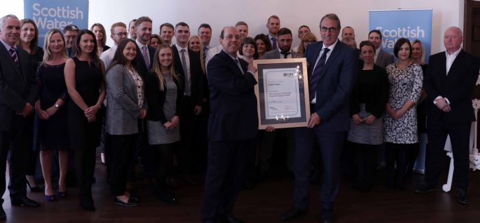 The Scottish Water team receive the accreditation from a CIPS representative