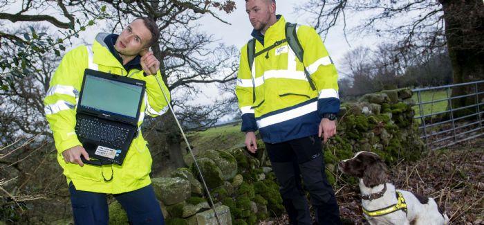 Scottish Water's Craig Garment and dog handler Luke Jones with Denzel (Credit: Scottish Water/SNS)