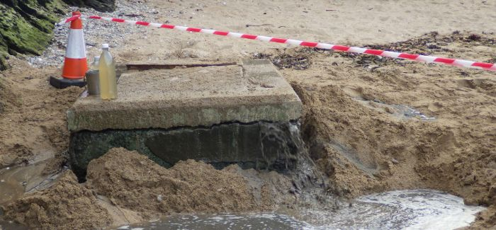 Sewage leaking from the manhole at South Sands Beach