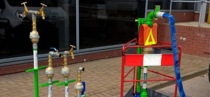 Severn Trent's authorised standpipes are painted bright green and feature the company logo