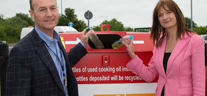 South Norfolk district councillor Lee Hornby and Anglian's Rachel Dyson with one of the new collection banks