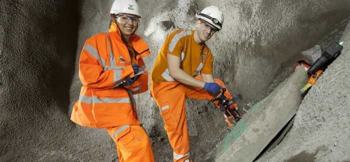 Engineering apprentices Regina Tumblepot (left) and Calvin Hall in the Crossrail Tunnel
