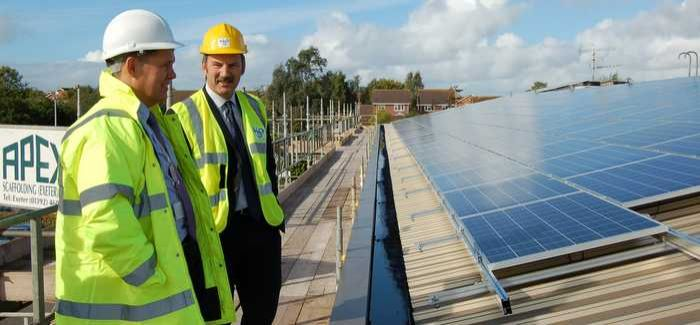 Project manager James Pearce (left) on the roof of Peninsula House with South West Water's director of engineering, Graham Murphy