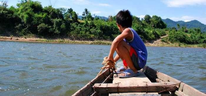Boy on a boat in the wetlands of Vietnam