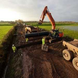 Raised road drainage solution for flood-prone Somerset village